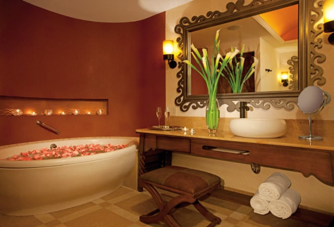 Suites at Secrets Puerto Los Cabos come complete with a vanity, bathtub and luxury linens.
