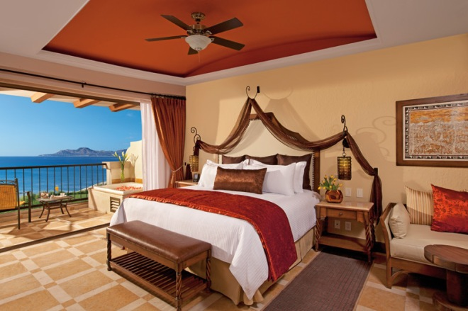 Luxurious accommodations including a king sized bed, sitting area and private terrace or balcony.