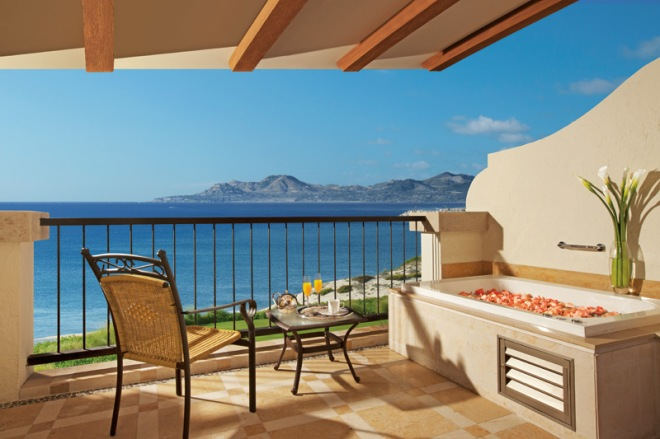 Enjoy your private terrace overlooking the ocean with a luxurious Jacuzzi tub.