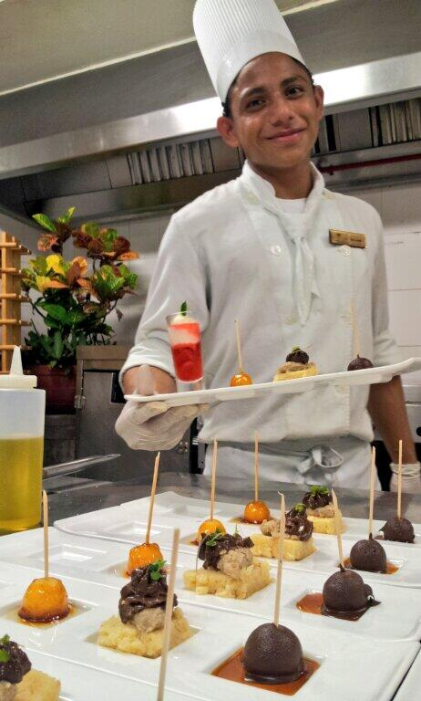 Chef Allan serves up dessert with a smile.