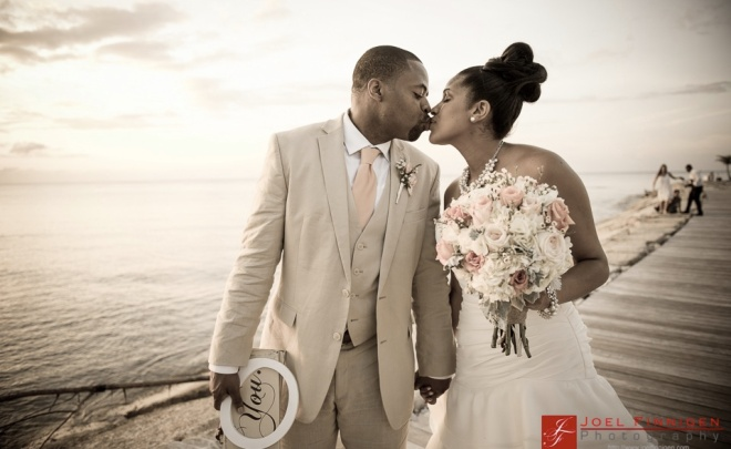 The duo shares a seaside smooch after the ceremony.