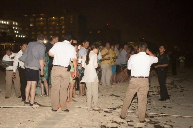 Guests gather around the beach in preparation for the release.