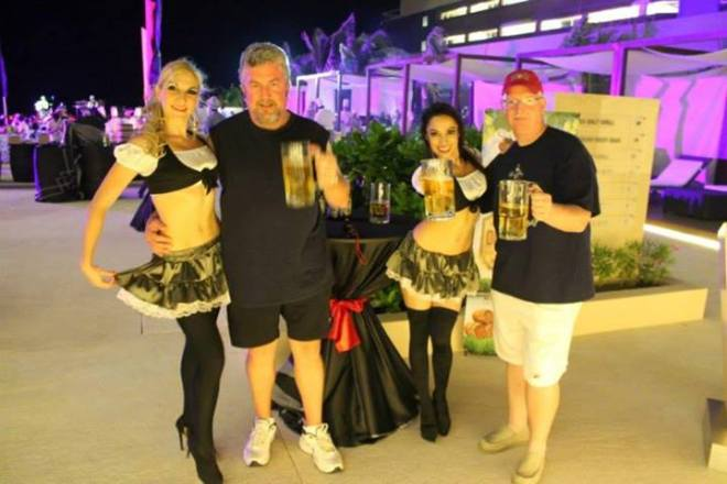 Two of our guests enjoying a pint with the ladies of Oktoberfest!