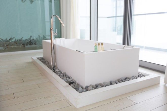 """An indoor infinity tub will leave you awe-inspired by views of the Caribbean Sea."""