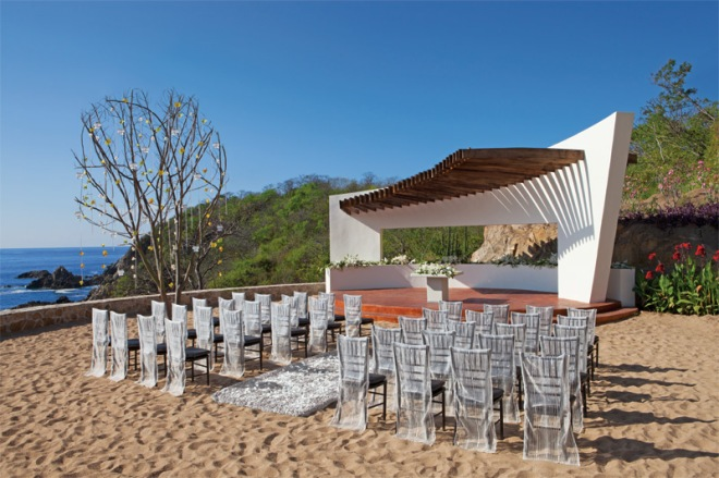 Couples can tie the knot on the golden sand beach under a modern gazebo at Secrets Huatulco Resort & Spa.