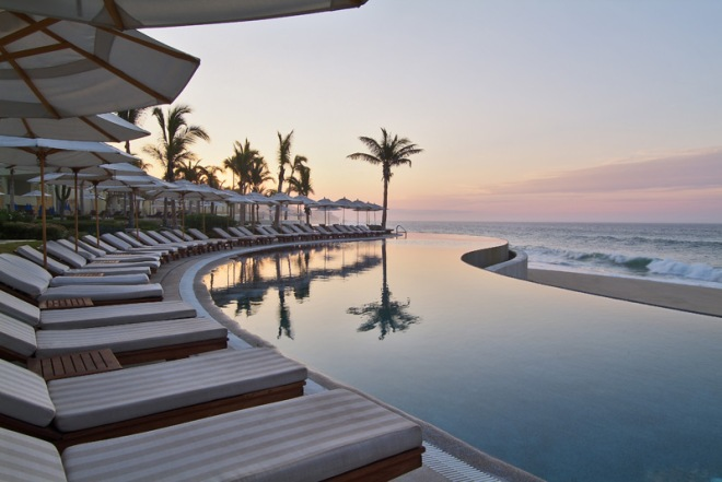 The glistening pool at Secrets Marquis Los Cabos at sunset