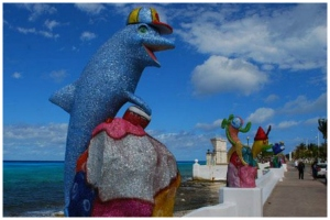 Colorful statues brighten Cozumel's main street.