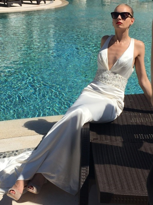 Even when the model is relaxing by the pool, she still channels her inner diva with this sleek and sultry gown.